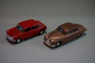 Two Spot-On tinplate cars, comprising: 'Jaguar S-Type'; and 'Austin 1800'. (2)