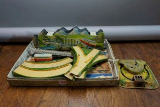 A vintage Technofix 'Mountain Express' tinplate clockwork train set, to include one coach, (no key);