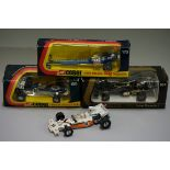 Four Corgi diecast racing cars, comprising: 170 'John Woolfe Dragster', boxed; 154 'JPS Lotus