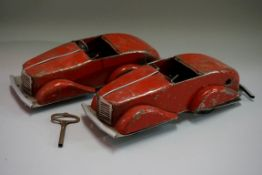 Two Louis Marx 'Toby Toys' tinplate clockwork four-speed streamline cars, 26.5cm long, (both a.