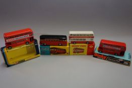 Three tinplate buses and a coach, comprising: Dinky 292 'Leyland Atlantean Bus', boxed; Dinky 295 '