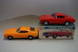 Two vintage tin plate battery operated cars, comprising: a Taiyo Chevrolet Camaro, boxed; and