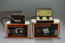 A Gaugemaster Model 'D' twin track controller; together with a Gaugemaster 'M' series transformer,