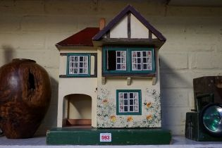 A vintage Triang 'Dolls' House No 23', 42cm high.