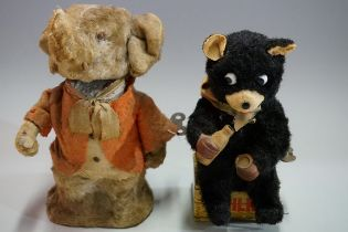 Two vintage plush-covered clockwork animals, comprising: a circus elephant, 17cm high; and a novelty