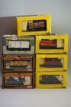 Seven boxed 'OO' gauge wagons, comprising: four Trix; two Mainline; and a Wrenn example. (7)