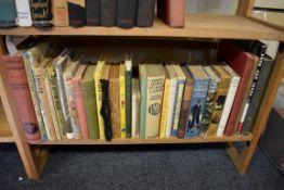 CHILDRENS BOOKS:a quantity on one shelf.