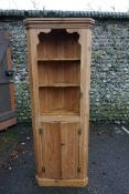 A pine corner cupboard, 183cm high.Payment must be made in advance of collection which is strictly