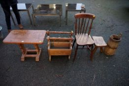 A small wooden table, milking stool, two magazine racks and a chair.Payment must be made in