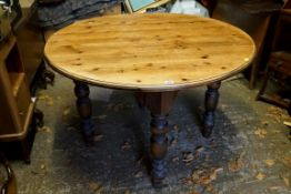 A pine circular kitchen table.Payment must be made in advance of collection which is strictly by