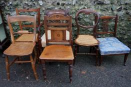 A sundry lot of chairs; to include: a cane seated chair and a kitchen chair.Payment must be made