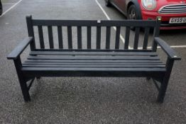 A black painted garden bench, 159cm wide.Payment must be made in advance of collection which is