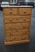 A pine chest of drawers, 89.5cm wide x 43.5cm deep x 126cm high.Payment must be made in advance of