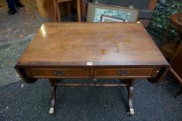 A reproduction inlaid mahogany sofa table, 91cm wide when closed, 145cm when open.Payment must be