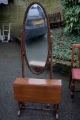 An oak cheval mirror; together with a Sutherland table.Payment must be made in advance of collection
