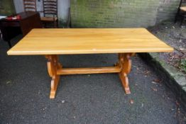 A refectory dining table,185cm wide x 80cm deep x 73cm high.Payment must be made in advance of