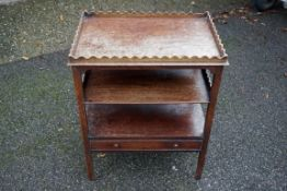 An old oak three tier stand having gallery top.Payment must be made in advance of collection which