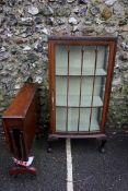 A 1960s mahogany bowfront display cabinet, 126cm high x 60cm wide; together with a reproduction