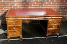 A large 1930s Continental walnut pedestal desk, 148cm wide x 92cm deep.Payment must be made in