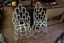 An unusual pair of novelty horseshoe garden chairs.Payment must be made in advance of collection