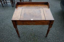 An antique mahogany clerk's desk, 79cm wide x 55cm deep x 80cm high.Payment must be made in