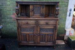 An old oak court cupboard, 122cm wide x 45cm deep x 143cm high.Payment must be made in advance of