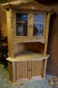 A pine standing corner cupboard.Payment must be made in advance of collection which is strictly by