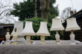 Three pairs of alabaster lamps.Payment must be made in advance of collection which is strictly by