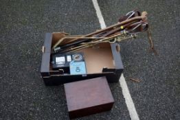 A quantity of shooting sticks, walking canes an electricity meter and an old wooden box.Payment must