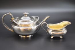 A George IV silver teapot, by Joseph AngellI, London 1825; together with a similar milk jug by