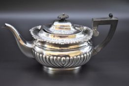 A late Victorian, Queen Anne style, silver teapot, byGeorge Nathan & Ridley Hayes, Chester 1900,