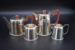 A silver four piece tea set, by Walker & Hall, Sheffield 1945, 1650g all in.