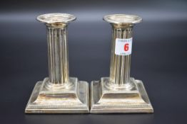 A pair of Victorian silver dwarf candlesticks, byHawksworth, Eyre & Co Ltd, Sheffield 1898, 12cm,