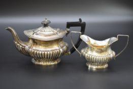 An Edwardian silver teapot and twin handled sugar bowl, byWilliam Adams Ltd, Birmingham 1907,