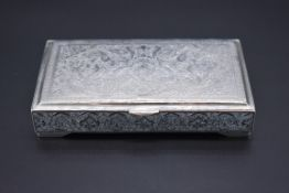 A Persian white metal cigarette box, probably Isfahan, stamped to inner lid, 14cm wide.