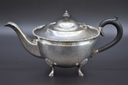 A silver teapot, byLevesley Brothers, Sheffield 1919, 14.5cm high, 670g all in.