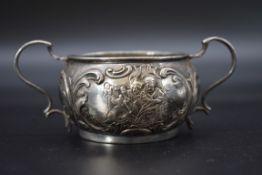 A German .800 twin handled sugar bowl, 4.5cm high.