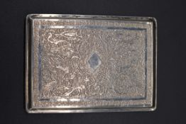 A Persian white metal cigarette case, stamped 'Varton A.O 84', having chased decoration, 10.5cm