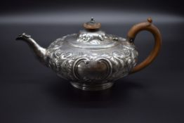 A Victorian silver tea pot of squat form, by Walter Morrisse, London 1856, 645g all in.