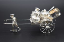 A Chinese silver novelty rickshaw condiment set, by Wai Kee, Hong Kong, stamped 'sterling silver',
