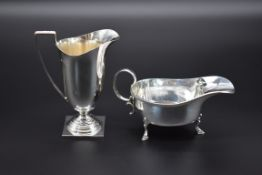 A silver cream helmet, byJames Dixon & Sons Ltd, Sheffield 1968, 12.7cm, 119g; together with a
