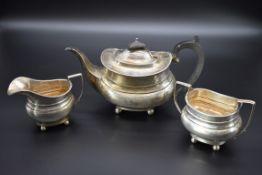 A Georgian style silver composite three piece tea set, byThomas Edward Atkins andErnest Druiff &