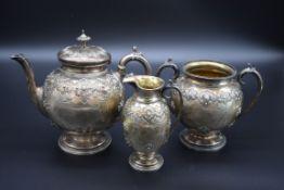 A Victorian silver three piece tea set, by John, Edward, Walter & John Barnard, London 1872 and