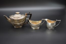 A composite Victorian silver bachelor's three piece tea set, byJames Deakin & Sons, Sheffield