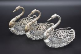 Three silver mounted cut glass swan bonbon dishes, By E Ltd, Import mark London 1962 and 1967, 12.