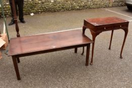 A low coffee table 128cm wide x 59cm deep; together with a two drawer side table.Collection of