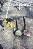 Two old warming pans; together with a painted mirror.Collection of this lot is strictly by