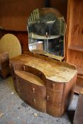 An Art Deco dressing table 124cm wide x 53cm deep; together with a bedside chest, 67cm high x 39cm