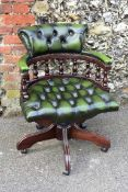 A reproduction Captain's chair.Collection of this lot is strictly by appointment on Saturday 17th
