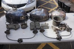 A collection of electroplate, to include a graduated set of three meat domes.